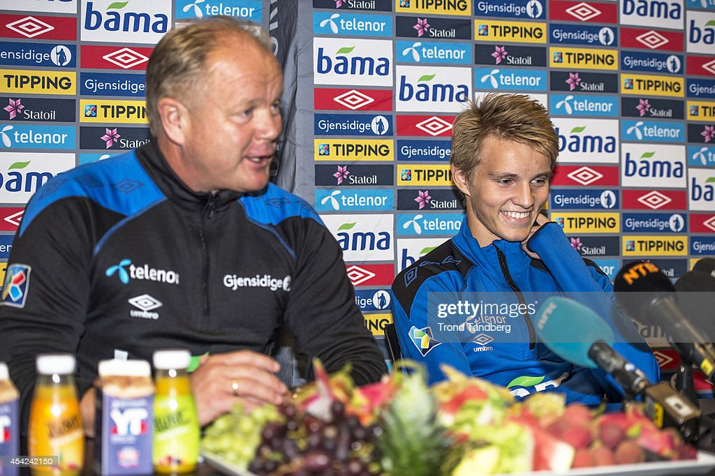 Martin Odegaard of Norway and Head Coach Per Mathias Hoegmo during a press conference at the Viking Stadion on August 26, 2014 in Stavanger, Norway. The 15 year old is set to become Norway's youngest ever international.