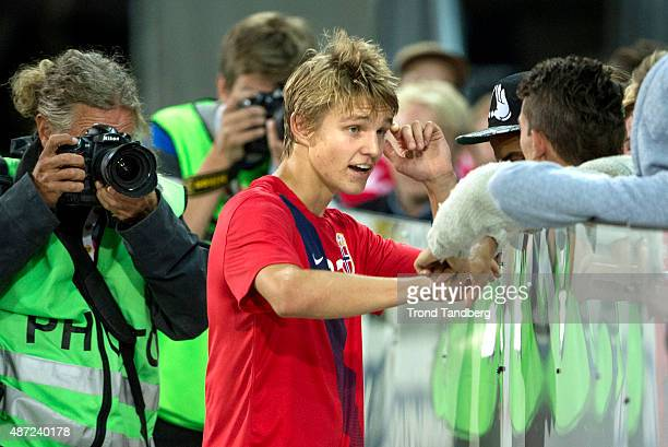 Martin Odegaard of Norway greets fans after the U21 International match between Norway and England at Marienlyst Stadium on September 7 2015 in...