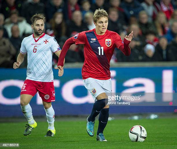 Martin Odegaard of Norway Paul Fenech of Malta during the EURO 2016 Qualifier between Norway and Malta at the Ullevaal Stadion on October 10 2015 in...