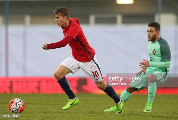 Martin Odegaard of Norway with Portugal's defender Kevin Rodrigues in action during the U21 International Friendly match between Portugal and Norway...