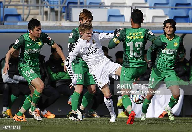 Martin Odegaard of Real Madrid Castilla in action during a friendly match between Real Madrid Castilla and Beijing Guoan at Estadio Alfredo Di...