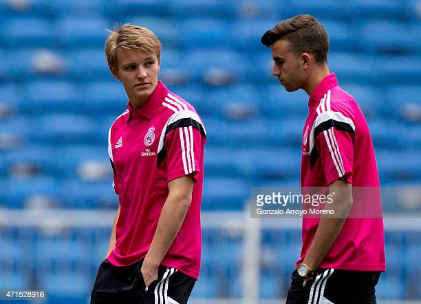 Martin Odegaard of Real Madrid CF and teammate Borja Mayoral leave the pitch before the La Liga match between Real Madrid CF and UD Almeria at...