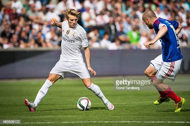 Martin Odegaard of Real Madrid Christian Grindheim of Vaalerenga during Preseason Friendly match between Vaalerenga and Real Madrid at Ullevaal...