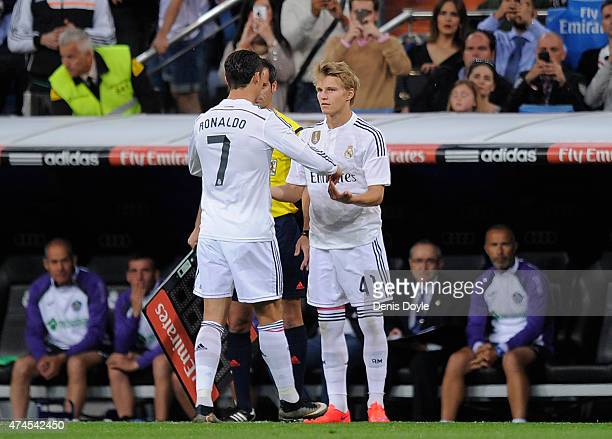 Martin Odegaard of Real Madrid comes on for Cristiano Ronaldo during the La Liga match between Real Madrid CF and Getafe CF at Estadio Santiago...