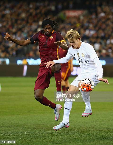 Martin Odegaard of Real Madrid is challenged by Gervinho of AS Roma during the International Champions Cup friendly match between Real Madrid and AS...