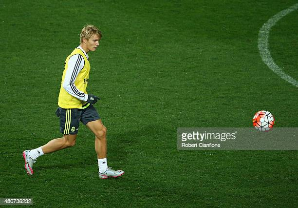 Martin Odegaard of Real Madrid kicks the ball during Real Madrid training session at Melbourne Cricket Ground on July 15 2015 in Melbourne Australia