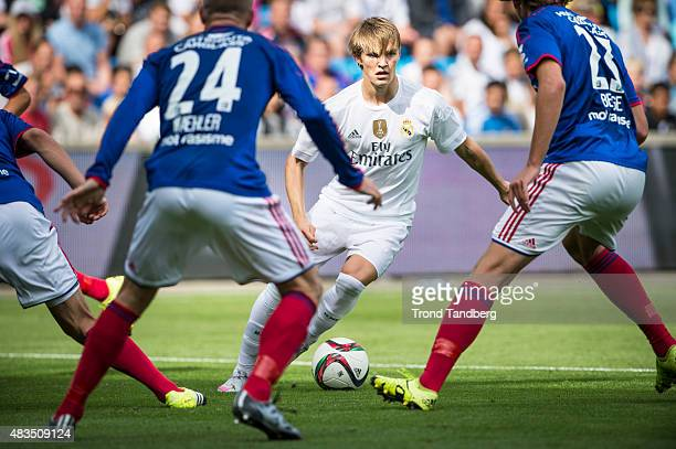 Martin Odegaard of Real Madrid Kjetil Whaeler and Sander Berge of Vaalerenga during Preseason Friendly match between Vaalerenga and Real Madrid at...