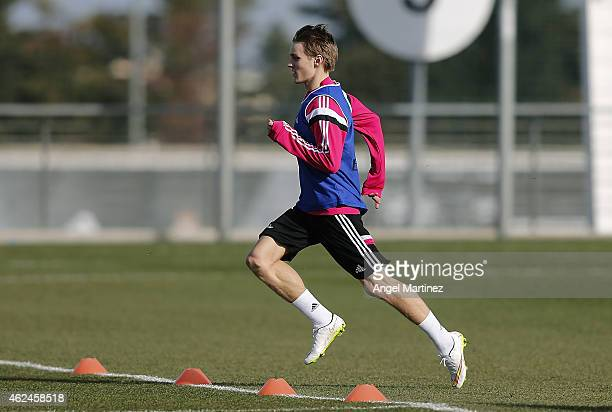 Martin Odegaard of Real Madrid runs during a training session at Valdebebas training ground on January 29 2015 in Madrid Spain