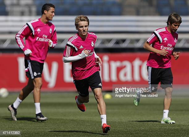 Martin Odegaard of Real Madrid warms up during a training session at Valdebebas training ground on April 28 2015 in Madrid Spain
