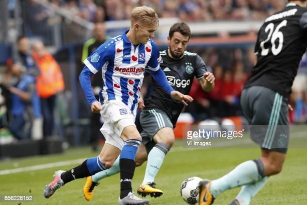 Martin Odegaard of sc Heerenveen Amin Younes of Ajax Nick Viergever of Ajax during the Dutch Eredivisie match between sc Heerenveen and Ajax...