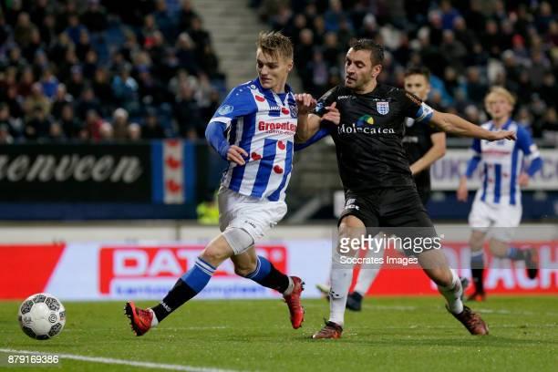 Martin Odegaard of SC Heerenveen Bram van Polen of PEC Zwolle during the Dutch Eredivisie match between SC Heerenveen v PEC Zwolle at the Abe Lenstra...
