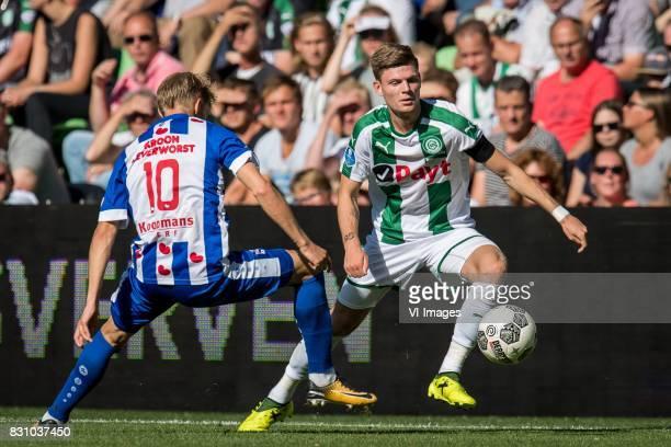 Martin Odegaard of sc Heerenveen Django Warmerdam of FC Groningen during the Dutch Eredivisie match between FC Groningen and sc Heerenveen at...