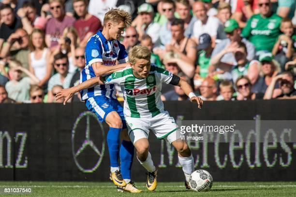 Martin Odegaard of sc Heerenveen Ritsu Doan of FC Groningen during the Dutch Eredivisie match between FC Groningen and sc Heerenveen at Noordlease...