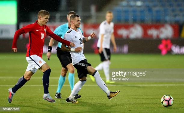 Martin Oedegaard of Norway and Marcel Hartel of Germany battle for the ball during the UEFA Under21 Euro 2019 Qualifier match between U21 of Norway...