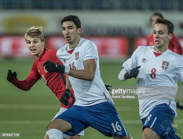 Martin Oedegaard of Norway Marko Grujic Nemanja Maksimovic of Serbia during U21UEFA European Championship PlayOff Norway v Serbia at Marienlyst...