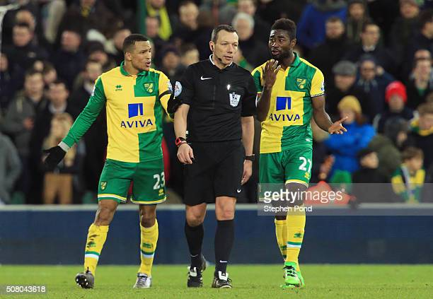 Martin Olsson and Alexander Tettey of Norwich City appeal to referee Kevin Friend during the Barclays Premier League match between Norwich City and...