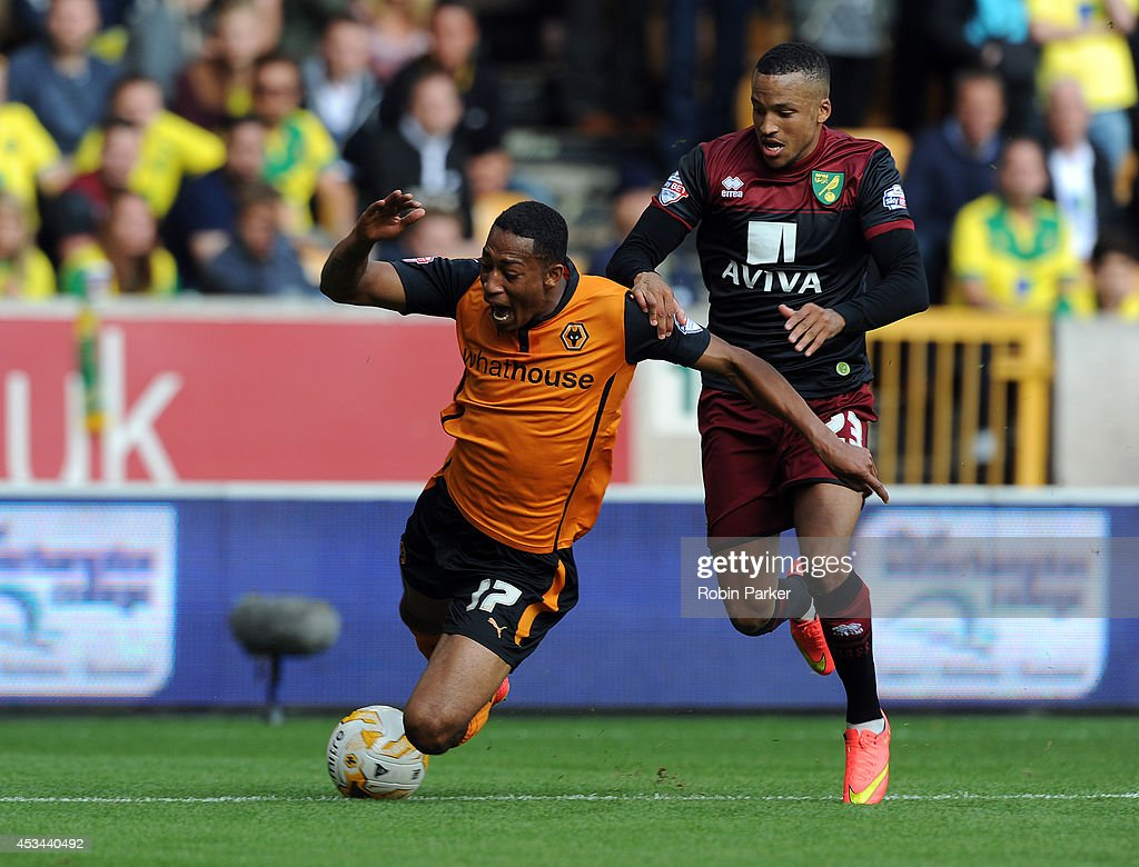 <a gi-track='captionPersonalityLinkClicked' href=/galleries/search?phrase=Martin+Olsson&family=editorial&specificpeople=4185617 ng-click='$event.stopPropagation()'>Martin Olsson</a> of Norwich City fouls Rajiv Van La Parra of Wolverhampton Wanderers for his 2nd yellow card and sending off during the Sky Bet Championship match between Wolverhampton Wanderers and Norwich City at the Molineux Stadium on August 10, 2014 in Wolverhampton, England.
