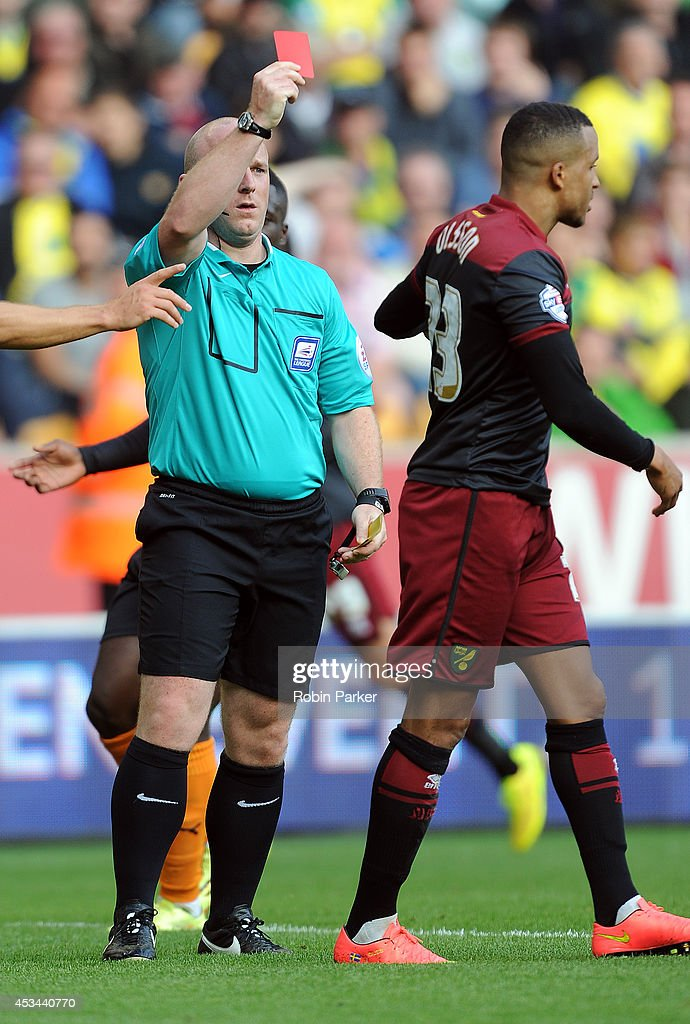 <a gi-track='captionPersonalityLinkClicked' href=/galleries/search?phrase=Martin+Olsson&family=editorial&specificpeople=4185617 ng-click='$event.stopPropagation()'>Martin Olsson</a> of Norwich City is shown the red card by referee Simon Hooper during the Sky Bet Championship match between Wolverhampton Wanderers and Norwich City at the Molineux Stadium on August 10, 2014 in Wolverhampton, England.