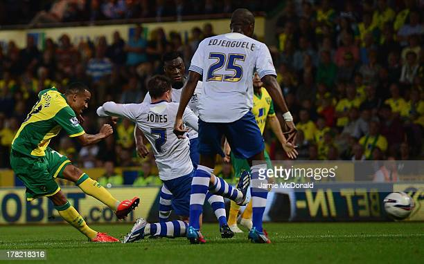 Martin Olsson of Norwich City scores his goal during the Capital One Cup second round match between Norwich City and Bury at Carrow Road on August 27...