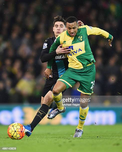 Martin Olsson of Norwich City tussles with Hector Bellerin of Arsenal during the Barclays Premier League match between Norwich City and Arsenal at...