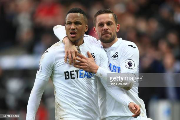 Martin Olsson of Swansea City celebrates scoring his sides second goal with Gylfi Sigurdsson of Swansea City during the Premier League match between...