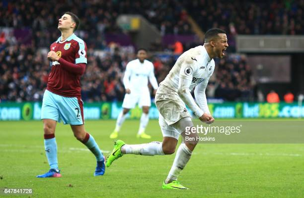 Martin Olsson of Swansea City celebrates scoring his sides second goal during the Premier League match between Swansea City and Burnley at Liberty...