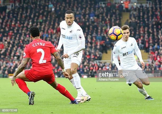 Martin Olsson of Swansea City chips the ball through for Tom Carroll to cross into the box to set up team mate Fernando Llorente second goal of the...