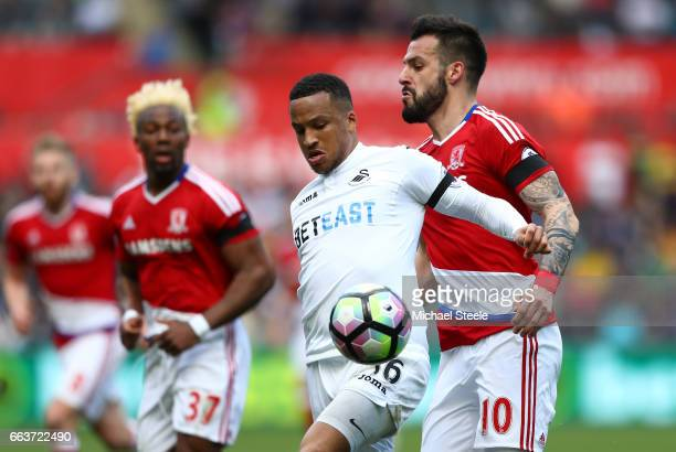 Martin Olsson of Swansea City is put under pressure from Alvaro Negredo of Middlesbrough during the Premier League match between Swansea City and...