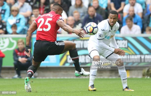 Martin Olsson of Swansea City marks Antonio Valencia of Manchester United during the Premier League match between Swansea City and Manchester United...