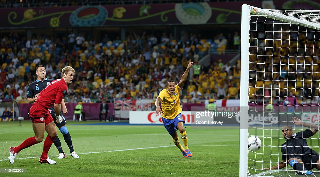 <a gi-track='captionPersonalityLinkClicked' href=/galleries/search?phrase=Martin+Olsson&family=editorial&specificpeople=4185617 ng-click='$event.stopPropagation()'>Martin Olsson</a> of Sweden celebrates after <a gi-track='captionPersonalityLinkClicked' href=/galleries/search?phrase=Glen+Johnson&family=editorial&specificpeople=209192 ng-click='$event.stopPropagation()'>Glen Johnson</a> of England fails to stop Olof Mellberg of Sweden's goal during the UEFA EURO 2012 group D match between Sweden and England at The Olympic Stadium on June 15, 2012 in Kiev, Ukraine.