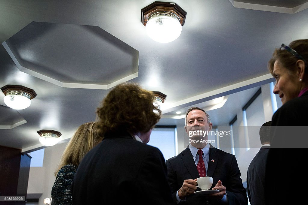 Martin O��Malley (D-MD), former Maryland governor and former 2016 presidential hopeful, mingles with guests before the start of a panel discussion at the National Press Club, May 6, 2016, in Washington, DC. The panel, titled 'Words Matter: the U.S. Debate over Immigration, the Media, and the 2016 Election,' was organized by the American Bar Association.