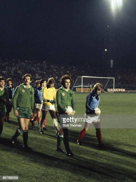 Martin O'Neill leads Northern Ireland and Asa Hartford leads Scotland out at Windsor Park in Belfast prior to their World Cup Qualifying match 14th...