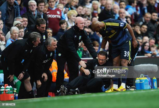 Martin O'Neill manager of Aston Villa is given assistance after colliding with Nicolas Anelka of Chelsea during the Barclays Premier League match...