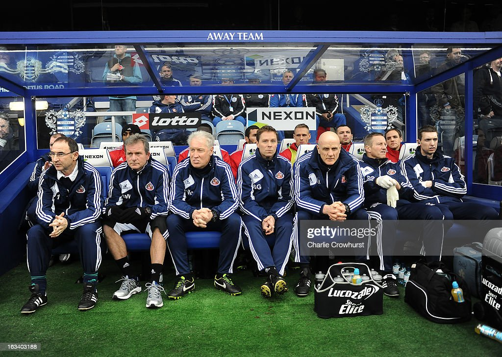 Martin O'Neill manager of Sunderland (L) and his coaching team look on from the dug out during the Barclays Premier League match between Queens Park Rangers and Sunderland at Loftus Road on March 9, 2013 in London, England.