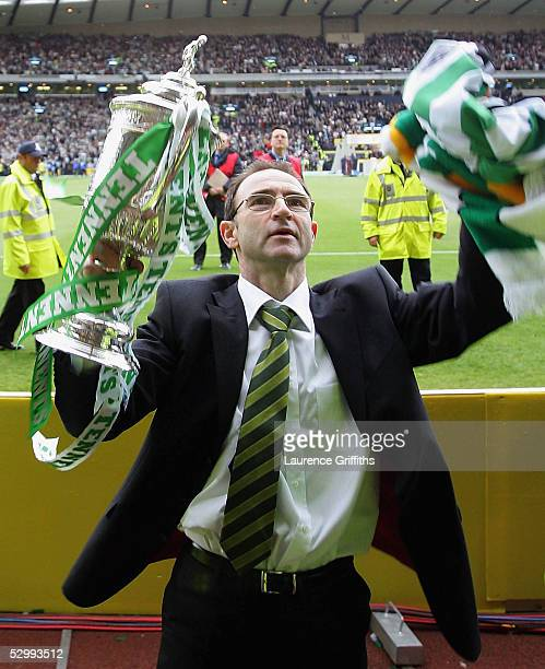 Martin O'Neill of Celtic celebrates with the trophy during The Tennents Scottish Cup Final between Celtic and Dundee United at Hampden Park on May 28...