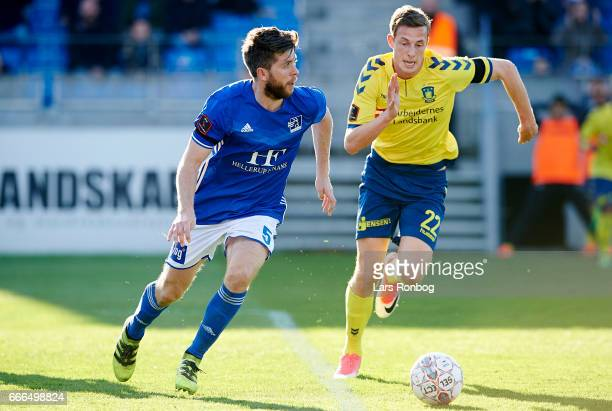 Martin Ornskov of Lyngby BK and Gustaf Nilsson of Brondby IF compete for the ball during the Danish Alka Superliga match between Lyngby BK and...