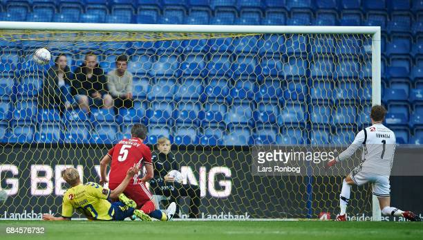 Martin Ornskov of Lyngby BK scores the 10 goal against Goalkeeper Frederik Ronnow of Brondby IF during the Danish Alka Superliga match between...