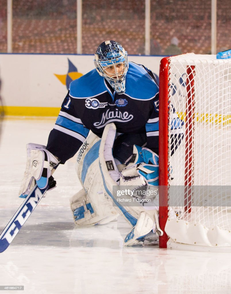 Martin Ouellette #51 of the Maine Black Bears looks for the puck during NCAA hockey action against the Boston University Terriers in the 'Citi Frozen Fenway 2014' at Fenway Park on January 11, 2014 in Boston, Massachusetts.