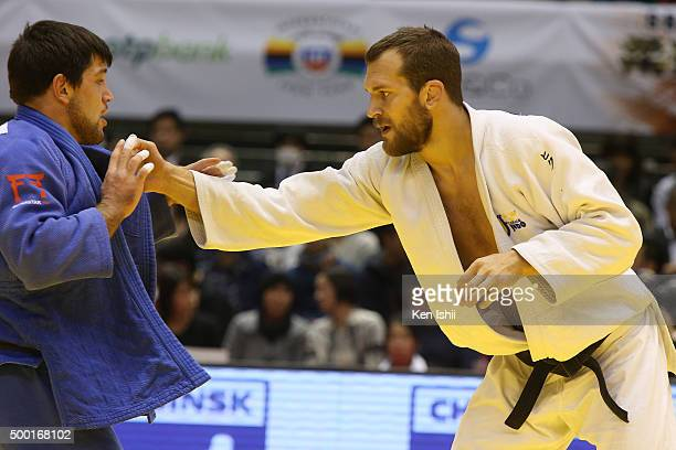 Martin Pacek of Sweden and Beka Gviniashvili of Georgia compete in the Men's 100kg preliminary at Tokyo Metropolitan Gymnasium on December 6 2015 in...
