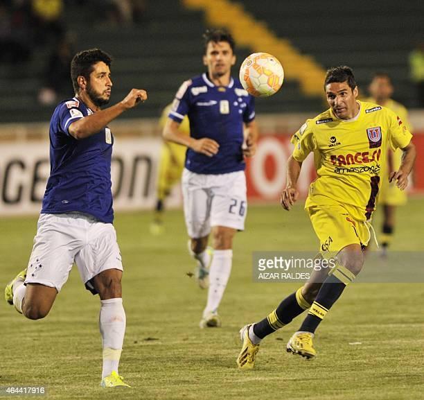 Martin Palavicini of Bolivian Universitario de Sucre and Leo of Brazil Cruzeiro vie for the ball during their Libertadores Cup football match in...