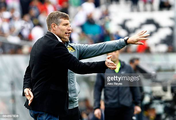 Martin Palermo head coach of Union Espanola gives intructions to his players during a match between Colo Colo and Union Espanola as part of...