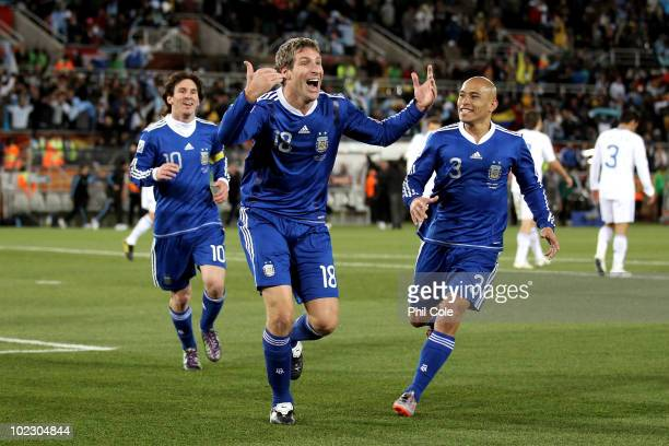 Martin Palermo of Argentina celebrates scoring the second goal with team mates Lionel Messi and Clemente Rodriguez during the 2010 FIFA World Cup...