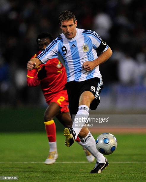 Martin Palermo of Argentina vies for the ball with Emmanuel Ansong of Ghana during a match as part of the International Friendly at Chateau Carrera...