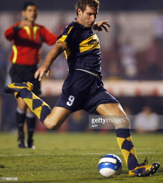Martin Palermo of Boca Juniors kicks the ball to mark the second goal against Sao Paulo during their Recopa Sudamericana football final match held at...