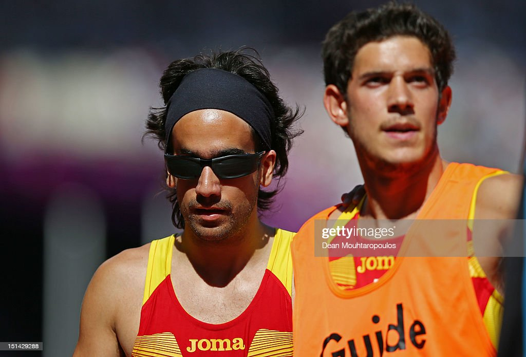 Martin Parejo Maza and Joan Borrisser Roldan (guide) of Spain compete in the Men's 100m — T11 heats on day 9 of the London 2012 Paralympic Games at Olympic Stadium on September 7, 2012 in London, England.
