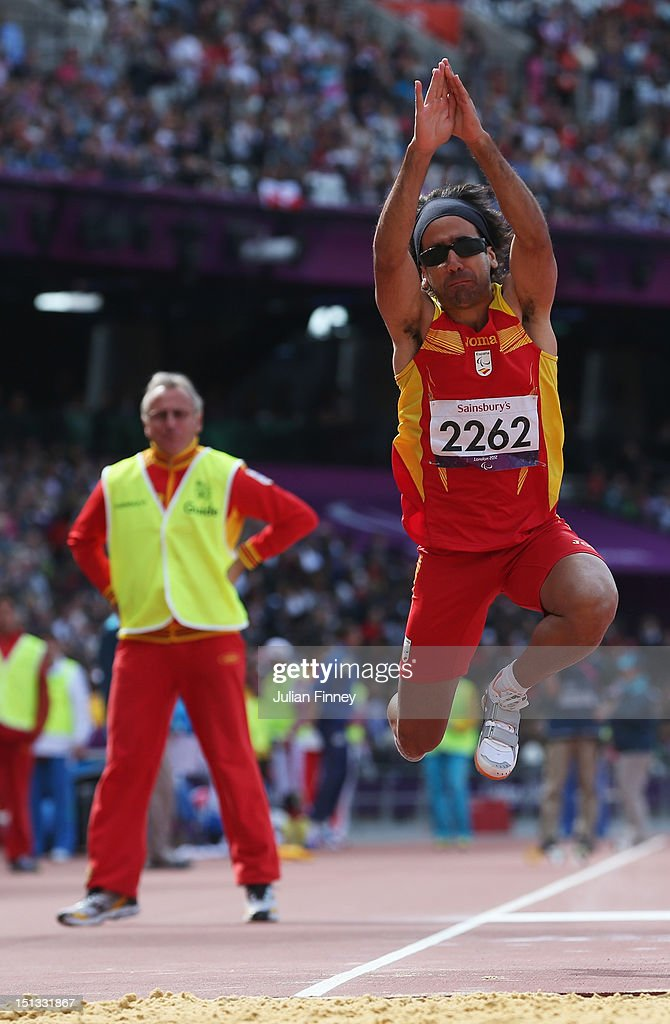 Martin Parejo Maza of Spain is assisted by his guide as he competes in the Men's Triple Jump - F11 Final on day 8 of the London 2012 Paralympic Games at Olympic Stadium on September 6, 2012 in London, England.