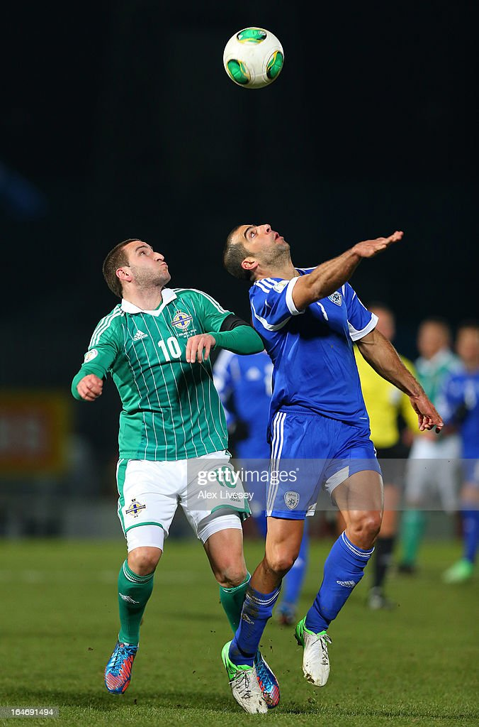 Martin Paterson of Northern Ireland and Tal ben Haim of Israel compete for the ball during the FIFA 2014 World Cup Group F Qualifier match between Northern Ireland and Israel at Windsor Park on March 26, 2013 in Belfast, Northern Ireland.