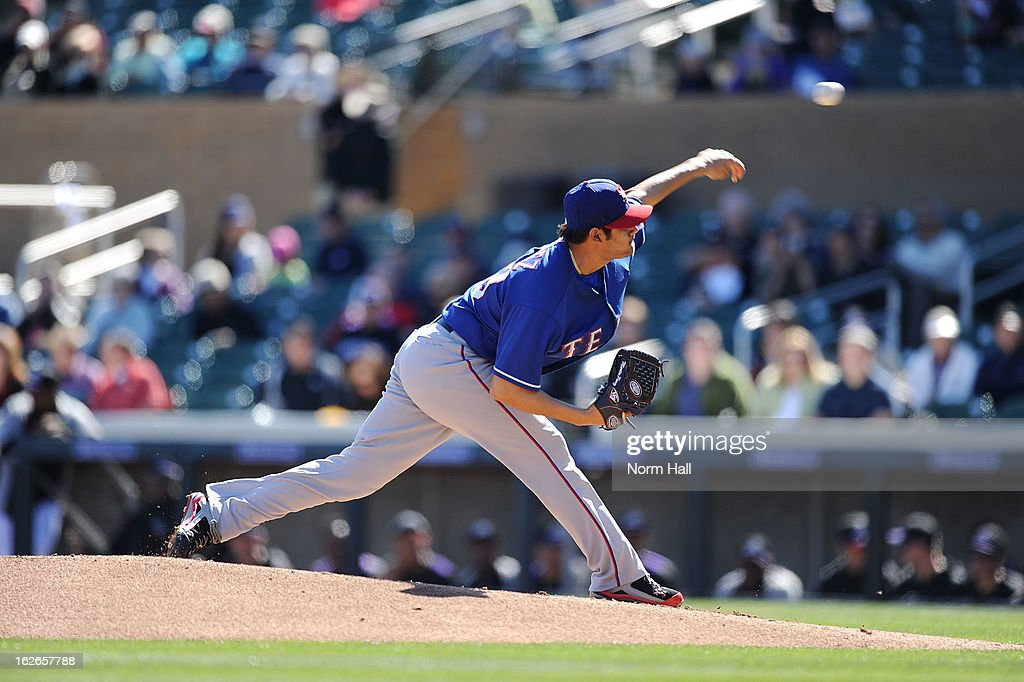 Martin Perez #33 of the Texas Rangers delivers a pitch against the Colorado Rockies at Salt River Field on February 25, 2013 in Scottsdale, Arizona.