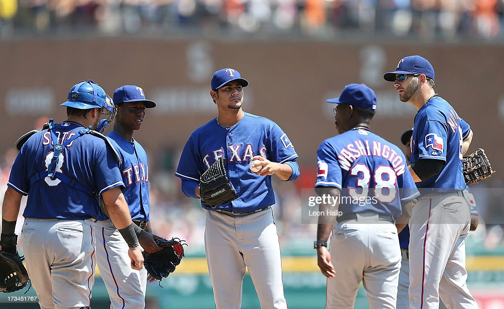 Martin Perez #33 of the Texas Rangers hands the ball to manager <a gi-track='captionPersonalityLinkClicked' href=/galleries/search?phrase=Ron+Washington&family=editorial&specificpeople=225012 ng-click='$event.stopPropagation()'>Ron Washington</a> #38 in the sixth inning of the game against the Detroit Tigers at Comerica Park on July 14, 2013 in Detroit, Michigan. The Tigers defeated the Rangers 5-0.