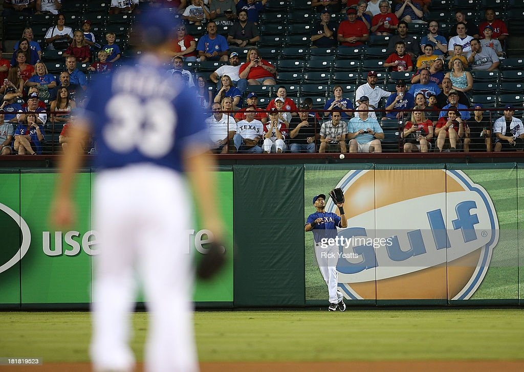 Martin Perez #33 of the Texas Rangers looks on in the second inning as <a gi-track='captionPersonalityLinkClicked' href=/galleries/search?phrase=Alex+Rios&family=editorial&specificpeople=224676 ng-click='$event.stopPropagation()'>Alex Rios</a> #51 of the Texas Rangers fields a fly ball hit by Chris Carter #23 of the Houston Astros (not pictured) at Rangers Ballpark in Arlington on September 25, 2013 in Arlington, Texas.